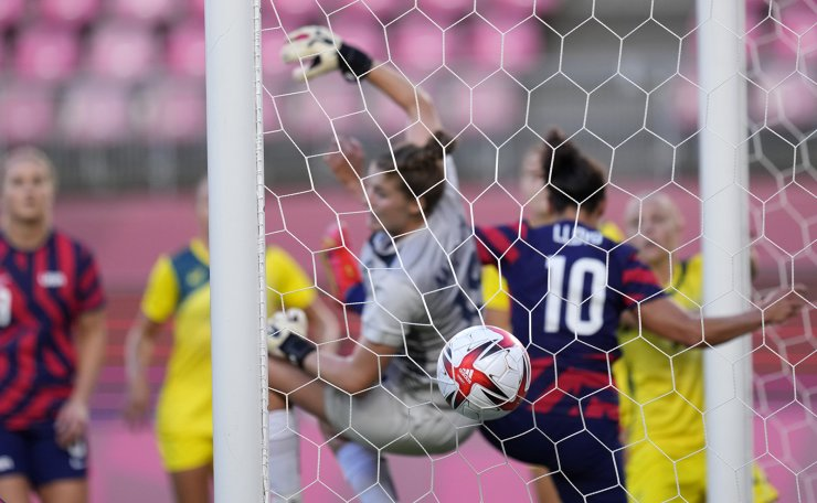The ball hits the net after United States' Megan Rapinoe scored the opening goal during the women's bronze medal soccer match against Australia at the 2020 Summer Olympics, Thursday, Aug. 5, 2021, in Kashima, Japan. AP