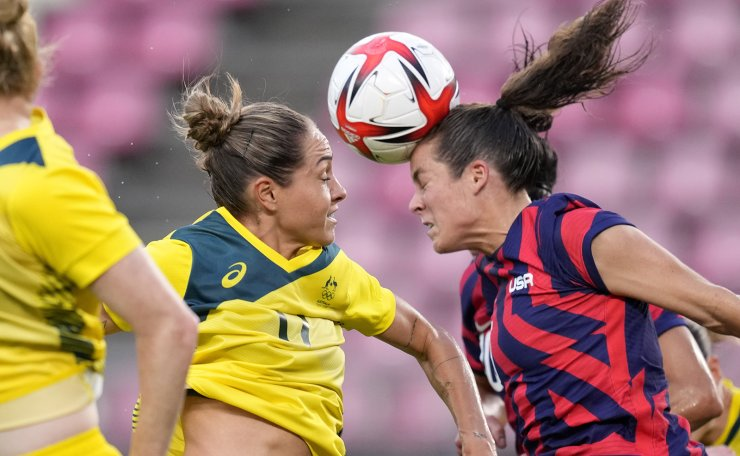 Australia's Mary Fowler, left, and United States' Kelley O'Hara go for a header during the women's bronze medal soccer match at the 2020 Summer Olympics, Thursday, Aug. 5, 2021, in Kashima, Japan. AP