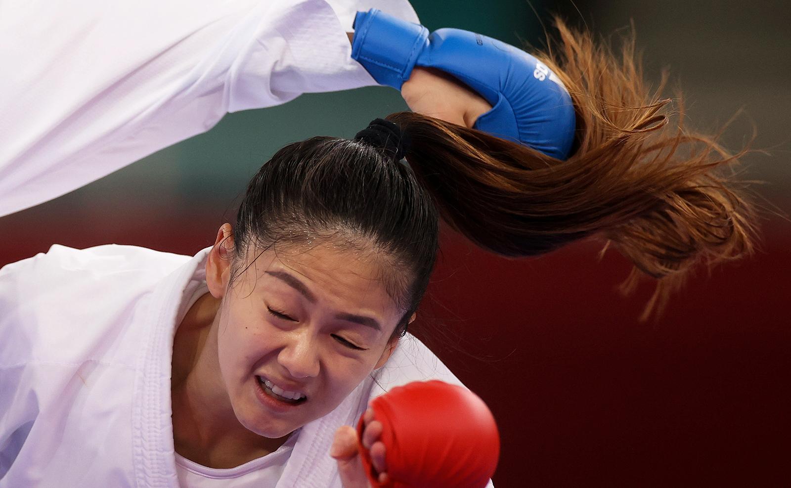 Tokyo 2020 Olympics - Karate - Women's -55kg Kumite - Pool A - Nippon Budokan, Tokyo, Japan - August 5, 2021. Wen Tzu-Yun of Taiwan reacts while in action against Sara Bahmanyar of Iran. REUTERS