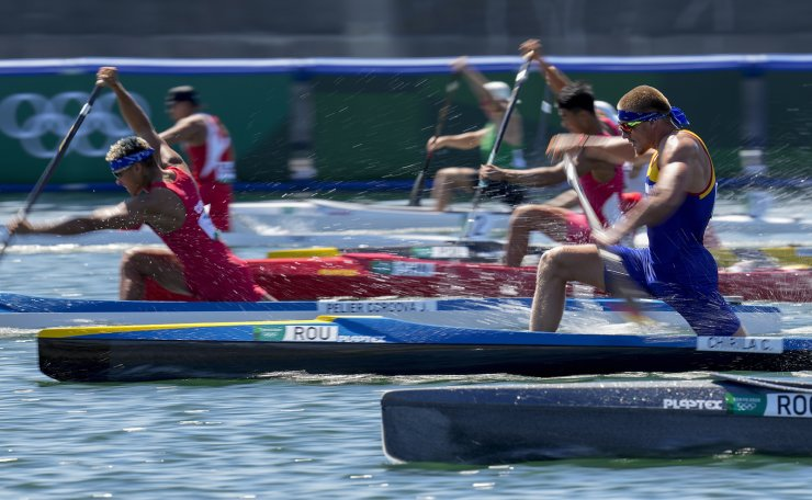 Catalin Chirila of Romania, right, competes in the men's canoe single 1000m heat during the 2020 Summer Olympics, Friday, Aug. 6, 2021, in Tokyo, Japan. AP