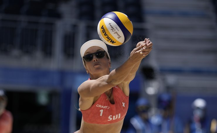 Anouk Verge-Depre, of Switzerland, stretches to hit the ball during a women's beach volleyball Bronze match against Latvia at the 2020 Summer Olympics, Friday, Aug. 6, 2021, in Tokyo, Japan. AP