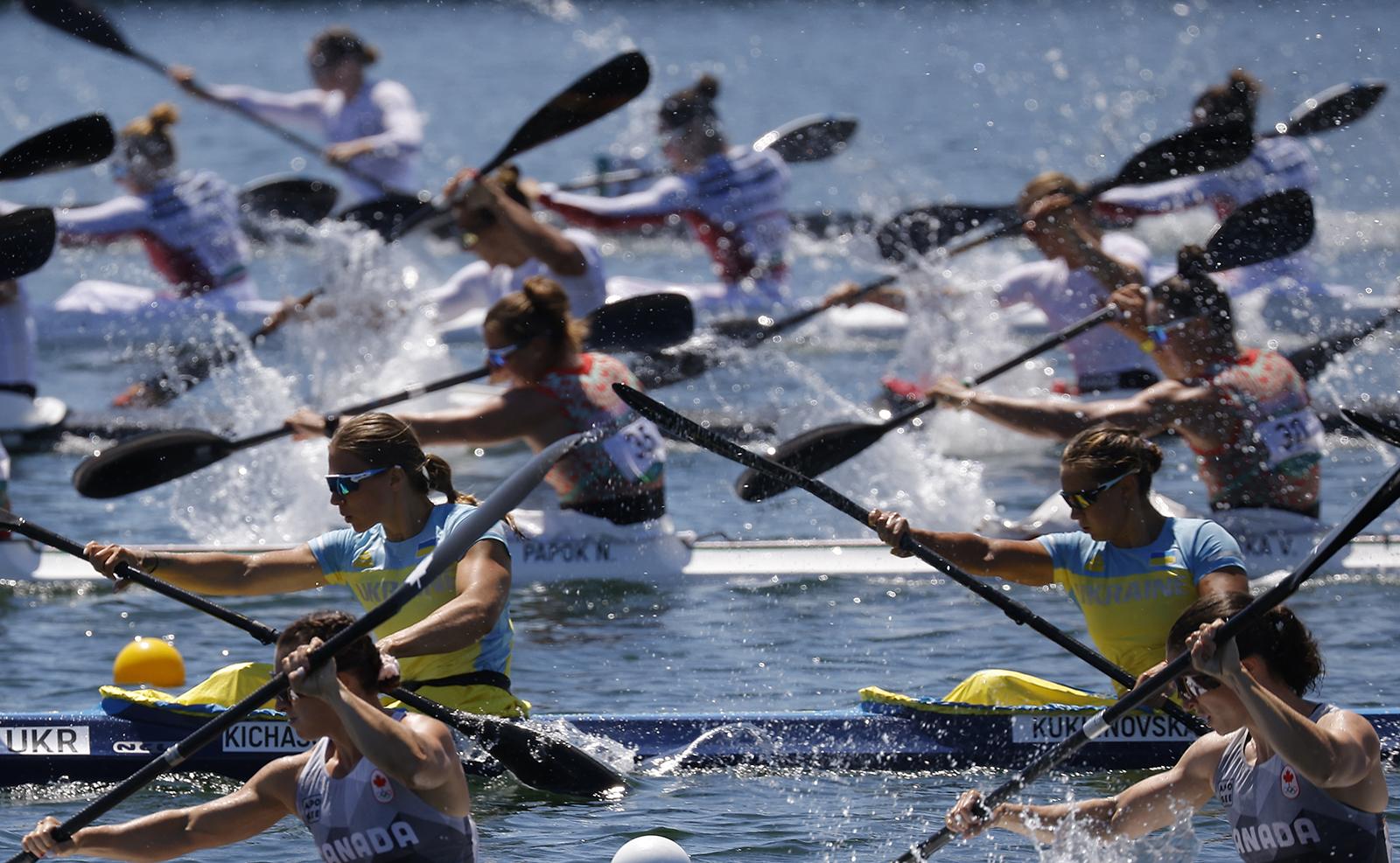 Tokyo 2020 Olympics - Canoe Sprint - Women's K4 500m - Heats - Sea Forest Waterway, Tokyo, Japan ? August 6, 2021. Members of team Canada, team Ukraine, team Belarus, team Hungary, team France and team New Zealand in action. REUTERS