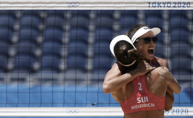 Anouk Verge-Depre, right, of Switzerland, and teammate Joana Heidrich celebrate winning a women's beach volleyball Bronze match against Latvia at the 2020 Summer Olympics, Friday, Aug. 6, 2021, in Tokyo, Japan. AP