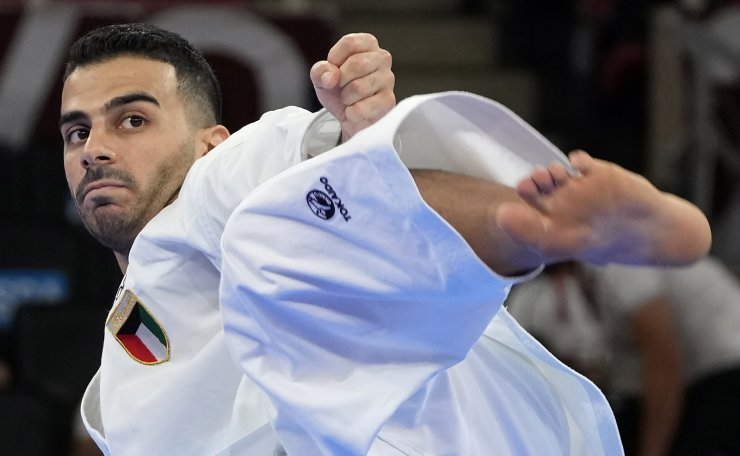 Sayed Mohammed Almosawi of Kuwait competes in the elimination round of the men's kata for Karate at the 2020 Summer Olympics, Friday, Aug. 6, 2021, in Tokyo, Japan. AP