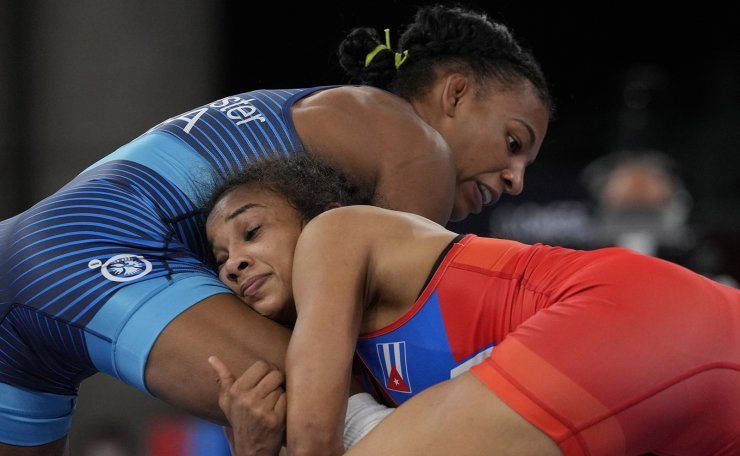 United States's Jacarra Gwenisha Winchester, left, competes against Cuba's Laura Herin Avila during their women's freestyle 53kg repechage wrestling match at the 2020 Summer Olympics, Friday, Aug. 6, 2021, in Chiba, Japan. AP