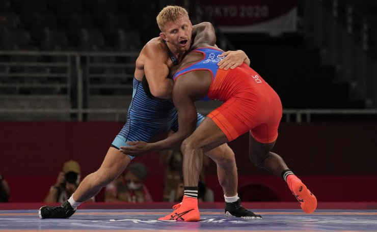 United State's Kyle Douglas Dake, left, competes against Cuba's Jeandry Garzon Caballero during their men's freestyle 74kg repechage wrestling match at the 2020 Summer Olympics, Friday, Aug. 6, 2021, in Chiba, Japan. AP