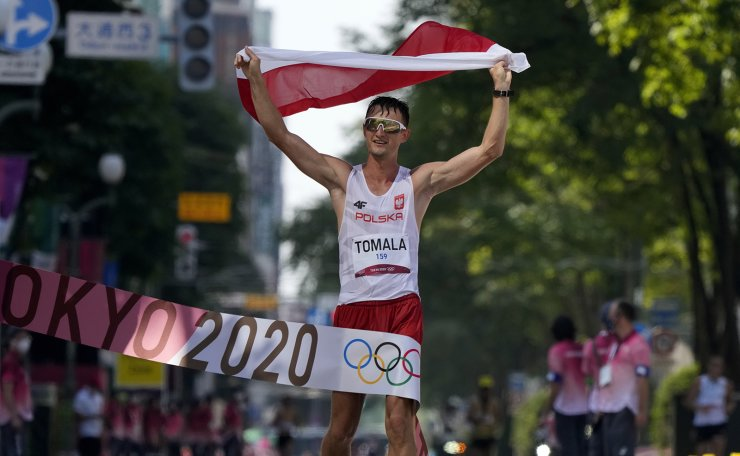 Dawid Tomala, of Poland, celebrates after placing first in the men's 50km race walk at the 2020 Summer Olympics, Friday, Aug. 6, 2021, in Sapporo, Japan. AP