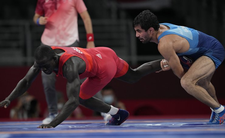 Uzbekistan's Bekzod Abdurakhmonov, right, competes against Guinea-Bissau Augusto Midana during their men's freestyle 74kg repechage wrestling match at the 2020 Summer Olympics, Friday, Aug. 6, 2021, in Chiba, Japan. AP