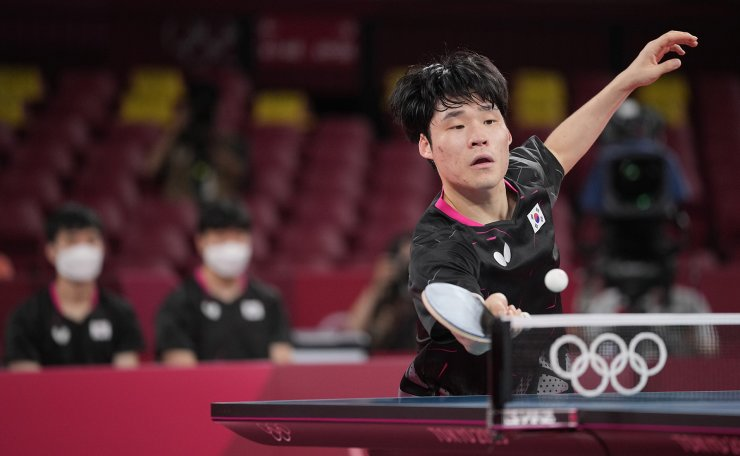 South Korea's Jang Woo-jin competes during the table tennis men's team bronze medal match against Japan's Tomokazu Harimoto at the 2020 Summer Olympics, Friday, Aug. 6, 2021, in Tokyo. AP