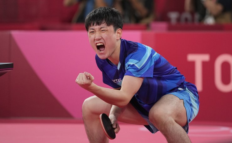 Japan's Tomokazu Harimoto reacts during the table tennis men's team bronze medal match against South Korea's Jang Woo-jin at the 2020 Summer Olympics, Friday, Aug. 6, 2021, in Tokyo. AP