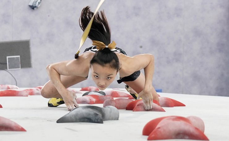 Seo Chae-hyun, of South Korea, competes during the speed portion of the women's sport climbing final at the 2020 Summer Olympics, Friday, Aug. 6, 2021, in Tokyo, Japan. AP