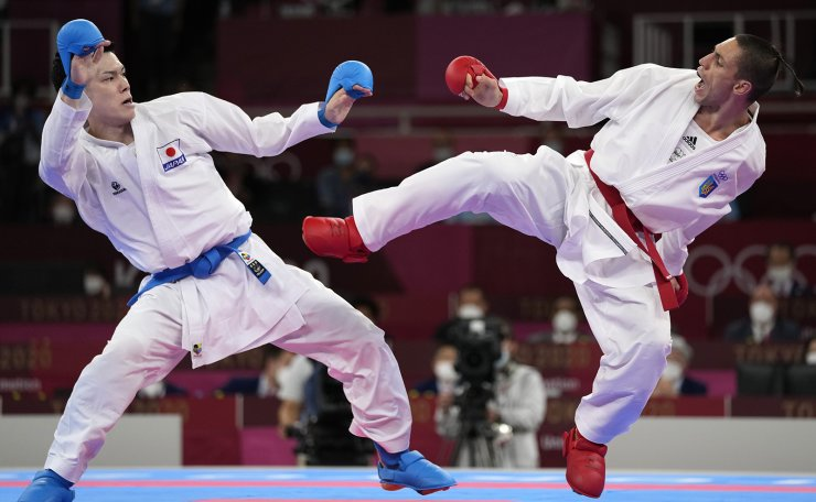 Ken Nishimura of Japan, left, and Stanislav Horuna of Ukraine compete in the men's kumite -75kg elimination round for karate at the 2020 Summer Olympics, Friday, Aug. 6, 2021, in Tokyo, Japan. AP
