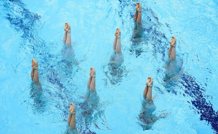 The Japan artistic swimming team competes during the team technical routine at the 2020 Summer Olympics, Friday, Aug. 6, 2021, in Tokyo, Japan. AP