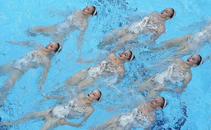 The Ukraine artistic swimming team competes during the team technical routine at the 2020 Summer Olympics, Friday, Aug. 6, 2021, in Tokyo, Japan. AP