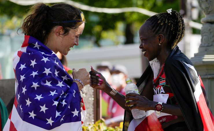 Race winner Peres Jepchirchir, right, of Kenya, gestures to third placed Molly Seidel, right, of the United States following the women's marathon at the 2020 Summer Olympics, Saturday, Aug. 7, 2021, in Sapporo, Japan. AP