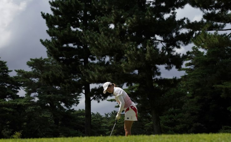 Mone Inami, of Japan, makes a putt on the 6th hole during the final round of the women's golf event at the 2020 Summer Olympics, Saturday, Aug. 7, 2021, at the Kasumigaseki Country Club in Kawagoe, Japan. AP
