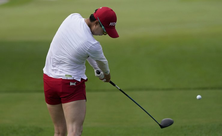 Hyojoo Kim, of South Korea, hits a tee shot on the 12th hole during the final round of the women's golf event at the 2020 Summer Olympics, Saturday, Aug. 7, 2021, at the Kasumigaseki Country Club in Kawagoe, Japan. AP