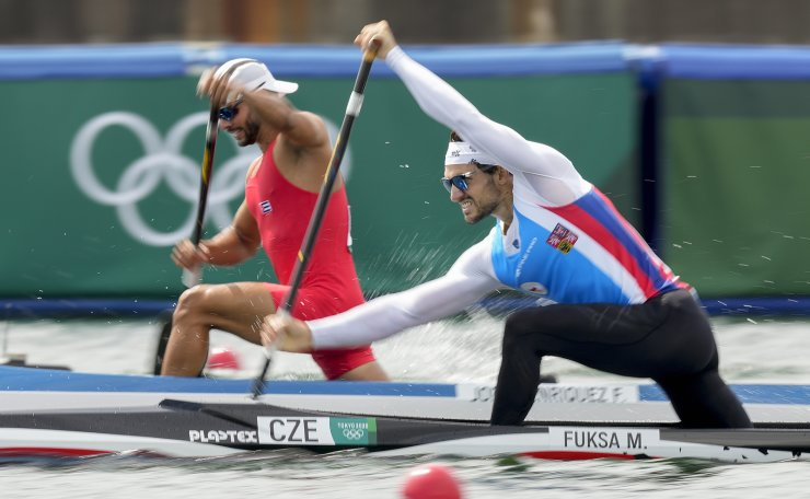 Martin Fuksa of the Czech Republic, right, and Fernando Dayan Jorge Enriquez of Cuba compete in the men's canoe single 1000m semifinal at the 2020 Summer Olympics, Saturday, Aug. 7, 2021, in Tokyo, Japan. AP