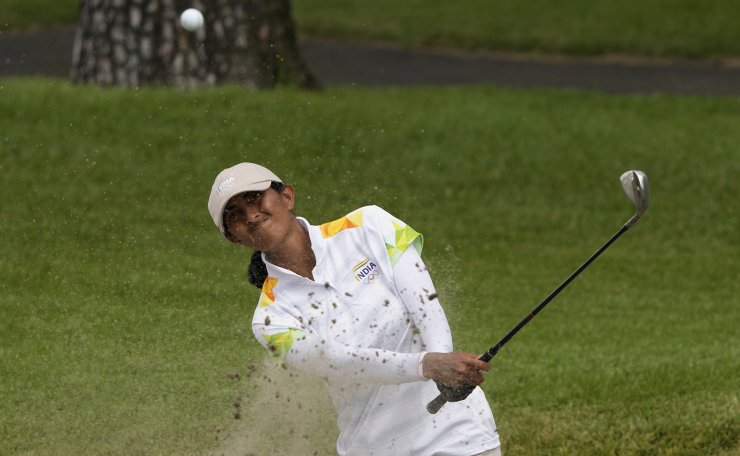 Aditi Ashok, of India, plays a shot from a bunker on the 7th hole during the final round of the women's golf event at the 2020 Summer Olympics, Saturday, Aug. 7, 2021, at the Kasumigaseki Country Club in Kawagoe, Japan. AP