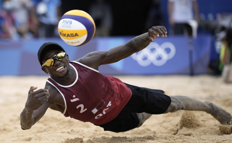 Ahmed Tijan, of Qatar, returns a shot during a men's beach volleyball Bronze Medal match against Latvia at the 2020 Summer Olympics, Saturday, Aug. 7, 2021, in Tokyo, Japan. AP