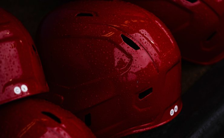 Raindrops collects on helmets ahead of the bronze medal baseball game between the Dominican Republic and South Korea at the 2020 Summer Olympics, Saturday, Aug. 7, 2021, in Yokohama, Japan. AP