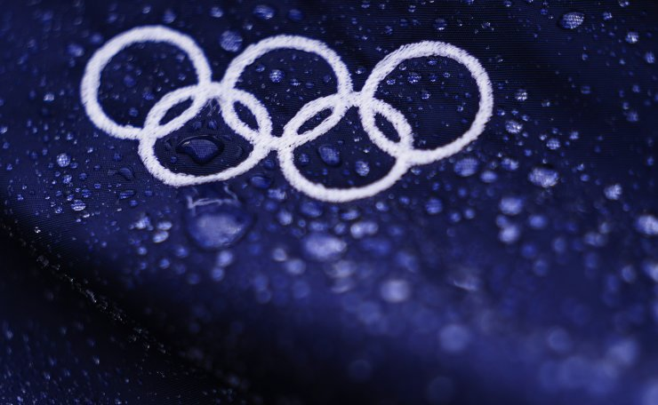 Raindrops collect on Olympic Rings ahead of the bronze medal baseball game between Dominican Republic and South Korea at the 2020 Summer Olympics, Saturday, Aug. 7, 2021, in Yokohama, Japan. AP