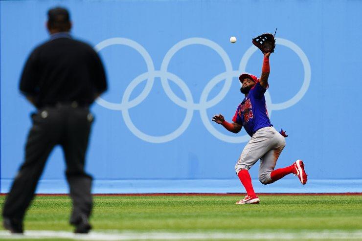 Dominican Republic's Emilio Bonifacio fields a single by South Korea's Kyoungmin Hur during the bronze medal baseball game at the 2020 Summer Olympics, Saturday, Aug. 7, 2021, in Yokohama, Japan. AP