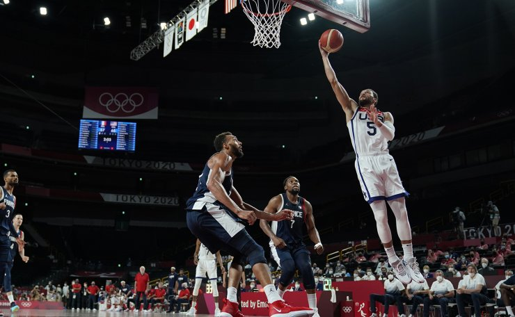 United States' Zachary Lavine (5) shoots over France's Rudy Gobert (27) during men's basketball gold medal game at the 2020 Summer Olympics, Saturday, Aug. 7, 2021, in Saitama, Japan. AP