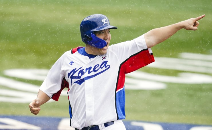 South Korea's Hyunsoo Kim reacts after scoring during the second inning of the bronze medal baseball game against South Korea at the 2020 Summer Olympics, Saturday, Aug. 7, 2021, in Yokohama, Japan. AP