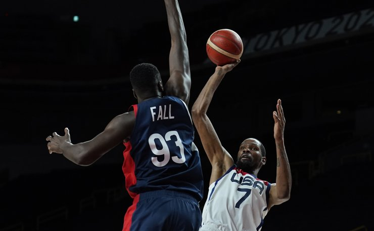 United States' Kevin Durant (7) shoots over France's Moustapha Fall (93) during men's basketball gold medal game at the 2020 Summer Olympics, Saturday, Aug. 7, 2021, in Saitama, Japan. AP