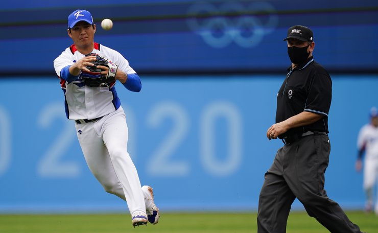South Korea's Ji Hwan Oh throws to first on a group out during the bronze medal baseball game at the 2020 Summer Olympics, Saturday, Aug. 7, 2021, in Yokohama, Japan. AP
