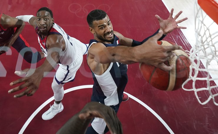 France's Timothe Luwawu Kongbo grabs a rebound over United States' Bam Adebayo, left, during the men's basketball gold medal game at the 2020 Summer Olympics, Saturday, Aug. 7, 2021, in Saitama, Japan. AP