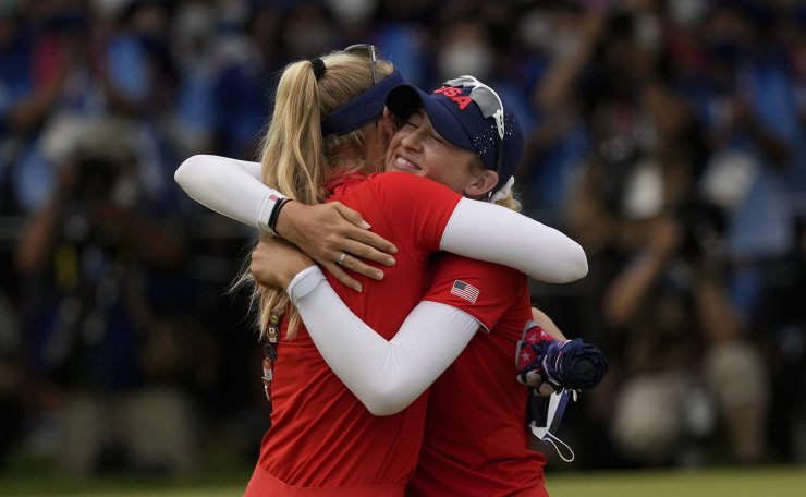 Nelly Korda, of the United States, right, is congratulated by her sister Jessica Korda after she winning the gold medal on the 18th hole during the final round of the women's golf event at the 2020 Summer Olympics, Saturday, Aug. 7, 2021, at the Kasumigaseki Country Club in Kawagoe, Japan. AP