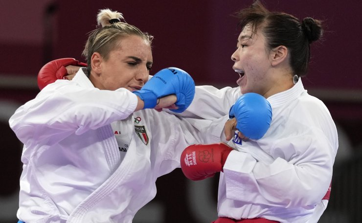 Silvia Semeraro of Italy, left, and Ayumi Uekusa of Japan compete in the women's kumite +61kg elimination round for karate at the 2020 Summer Olympics, Saturday, Aug. 7, 2021, in Tokyo, Japan. AP