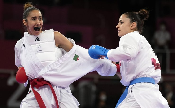 Lamya Matoub of Algeria, left, and Elena Quirici of Switzerland compete in the women's kumite +61kg elimination round for karate at the 2020 Summer Olympics, Saturday, Aug. 7, 2021, in Tokyo, Japan. AP