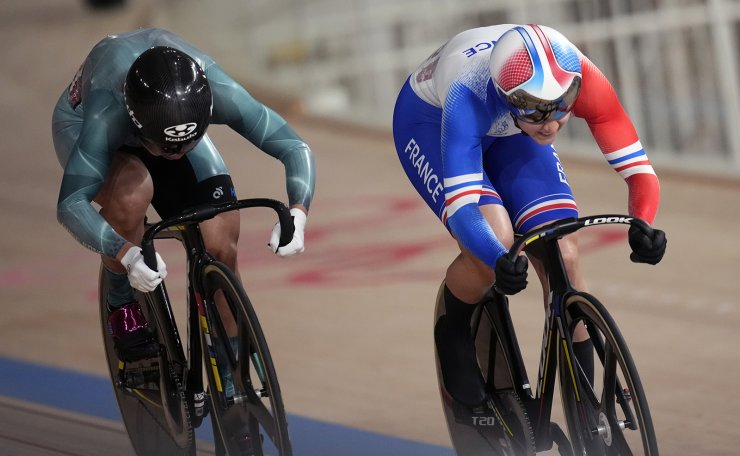 Mathilde Gros of Team France, right, and Wai Sze Lee of Team Hong Kong competes during the track cycling women's sprint race at the 2020 Summer Olympics, Saturday, Aug. 7, 2021, in Izu, Japan. AP