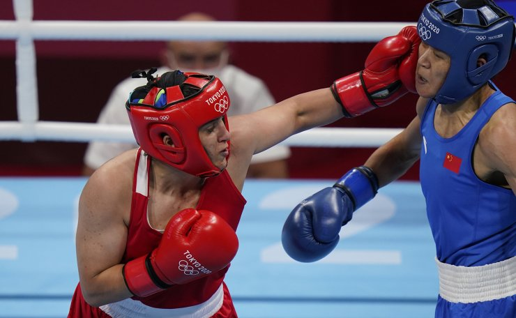 Turkey's Busenaz Surmeneli, left, exchanges punches with China's Cu Hong during their women's welterweight 69-kg boxing gold medal match at the 2020 Summer Olympics, Saturday, Aug. 7, 2021, in Tokyo, Japan. AP