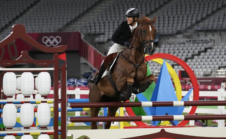 Jung Jinhwa of South Korea competes in the equestrian portion of the men's modern pentathlon at the 2020 Summer Olympics, Saturday, Aug. 7, 2021, in Tokyo, Japan. AP