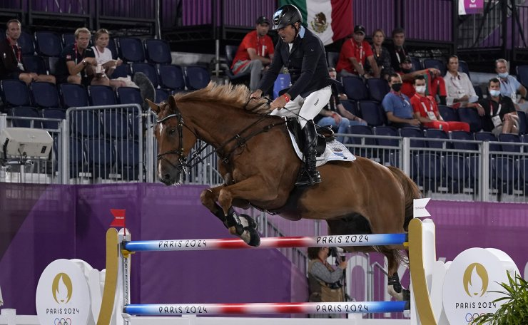 Argentina's Fabian Sejanes, riding Emir, competes during the equestrian jumping team final at Equestrian Park in Tokyo at the 2020 Summer Olympics, Saturday, Aug. 7, 2021, in Tokyo, Japan. AP