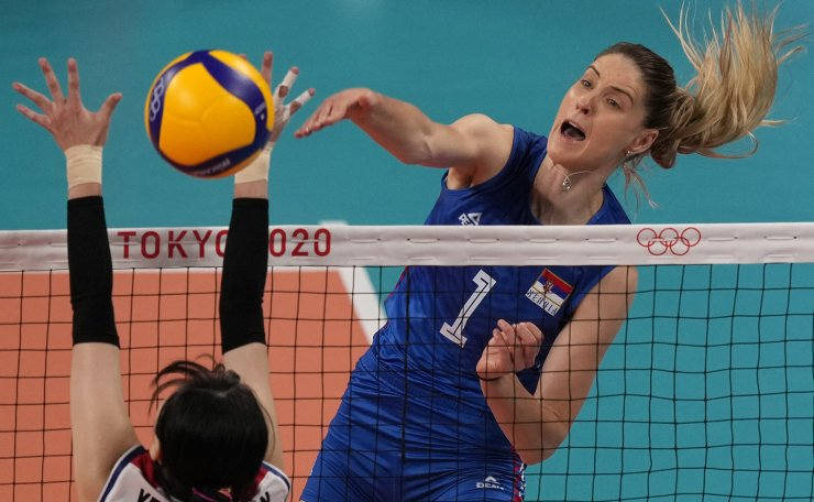 Serbia's Bianka Busa spikes the ball as Korea's Yeum Hye Seon defends during the bronze medal match in women's volleyball at the 2020 Summer Olympics, Sunday, Aug. 8, 2021, in Tokyo, Japan. AP