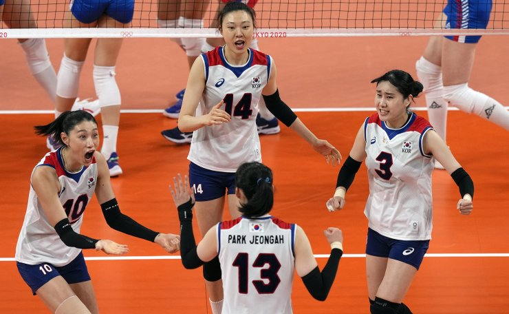 Players from Korea celebrate a point against Serbia during the bronze medal match in women's volleyball at the 2020 Summer Olympics, Sunday, Aug. 8, 2021, in Tokyo, Japan. AP