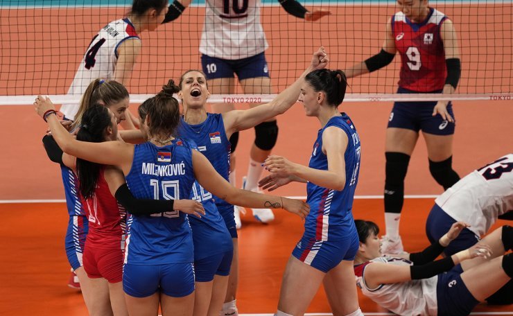 Players from Serbia celebrate a point against Korea during the bronze medal match in women's volleyball at the 2020 Summer Olympics, Sunday, Aug. 8, 2021, in Tokyo, Japan. AP