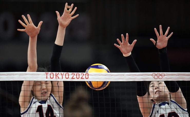 Korea's Yang Hyo Jin, left, and Park Jeongah jump to block a shot from Serbia during the bronze medal match in women's volleyball at the 2020 Summer Olympics, Sunday, Aug. 8, 2021, in Tokyo, Japan. AP