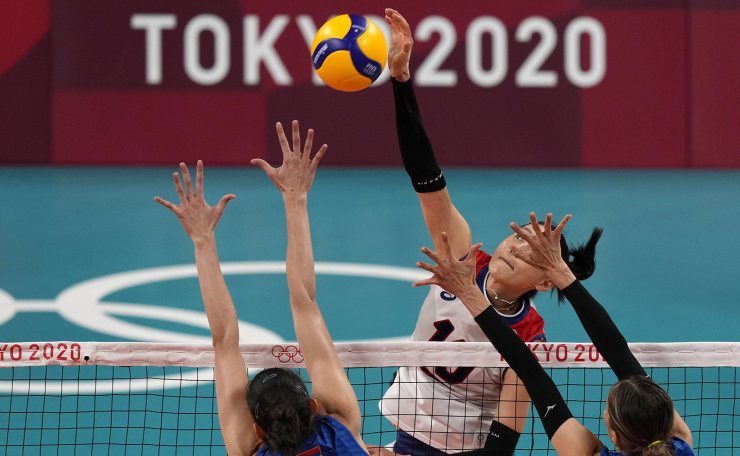 Korea's Kim Yeon Koung spikes while playing Serbia during the bronze medal match in women's volleyball at the 2020 Summer Olympics, Sunday, Aug. 8, 2021, in Tokyo, Japan. AP