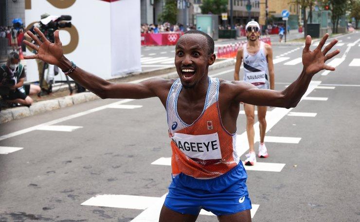 Tokyo 2020 Olympics - Athletics - Men's Marathon - Sapporo Odori Park, Sapporo, Japan - August 8, 2021. Abdi Nageeye of the Netherlands celebrates after winning silver. REUTERS