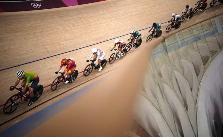 Riders compete during the track cycling women's omnium race at the 2020 Summer Olympics, Sunday, Aug. 8, 2021, in Izu, Japan. AP