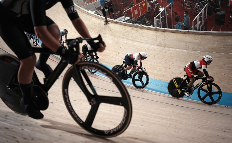 Riders compete during the track cycling women's omnium scratch race at the 2020 Summer Olympics, Sunday, Aug. 8, 2021, in Izu, Japan. AP