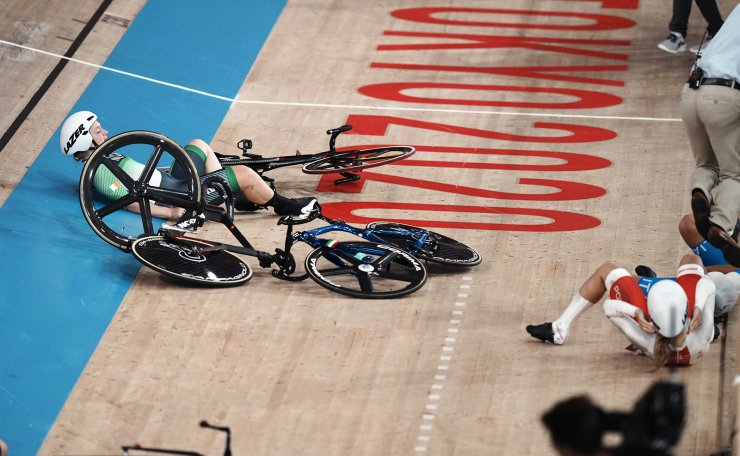 Riders crash during the track cycling women's omnium scratch race at the 2020 Summer Olympics, Sunday, Aug. 8, 2021, in Izu, Japan. AP