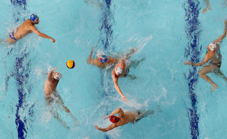 Tokyo 2020 Olympics - Water Polo - Men - Final 7-8 - Montenegro v Italy - Tatsumi Water Polo Centre, Tokyo, Japan - August 8, 2021. Slaven Kandic of Montenegro and Vladan Spaic of Montenegro in action. REUTERS