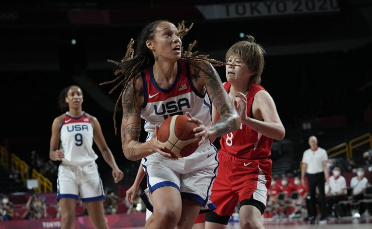 United States' Brittney Griner (15), center, drives Japan's Maki Takada (8) during women's basketball gold medal game at the 2020 Summer Olympics, Sunday, Aug. 8, 2021, in Saitama, Japan. AP